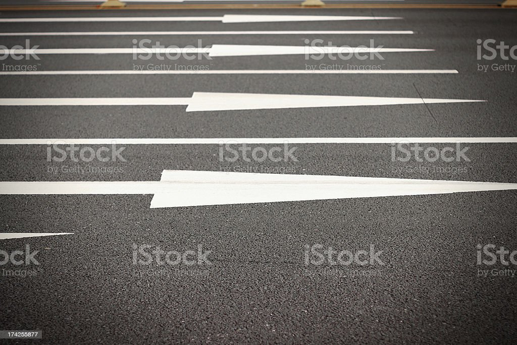 White arrow on an empty parking lot royalty-free stock photo