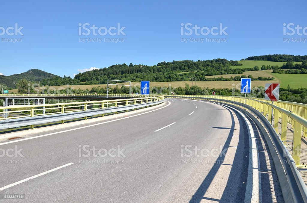 White arrow on blue background and red arrow by roadside stock photo