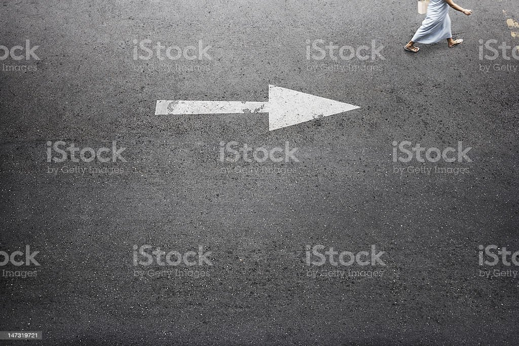 White Arrow Road with Woman royalty-free stock photo