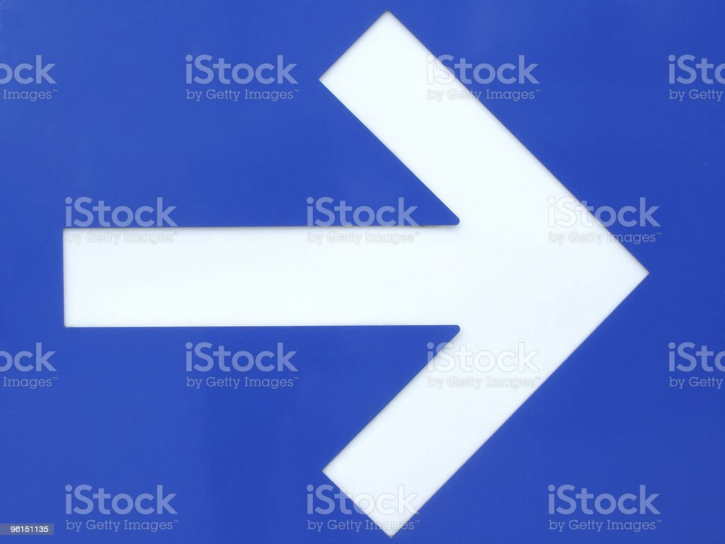 White arrow sign on blue metallic background. royalty-free stock photo