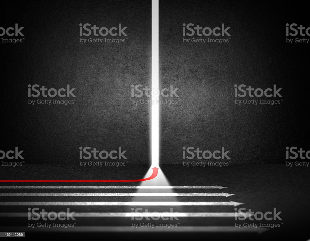 White arrows pointing straight and a red arrow curving stock photo