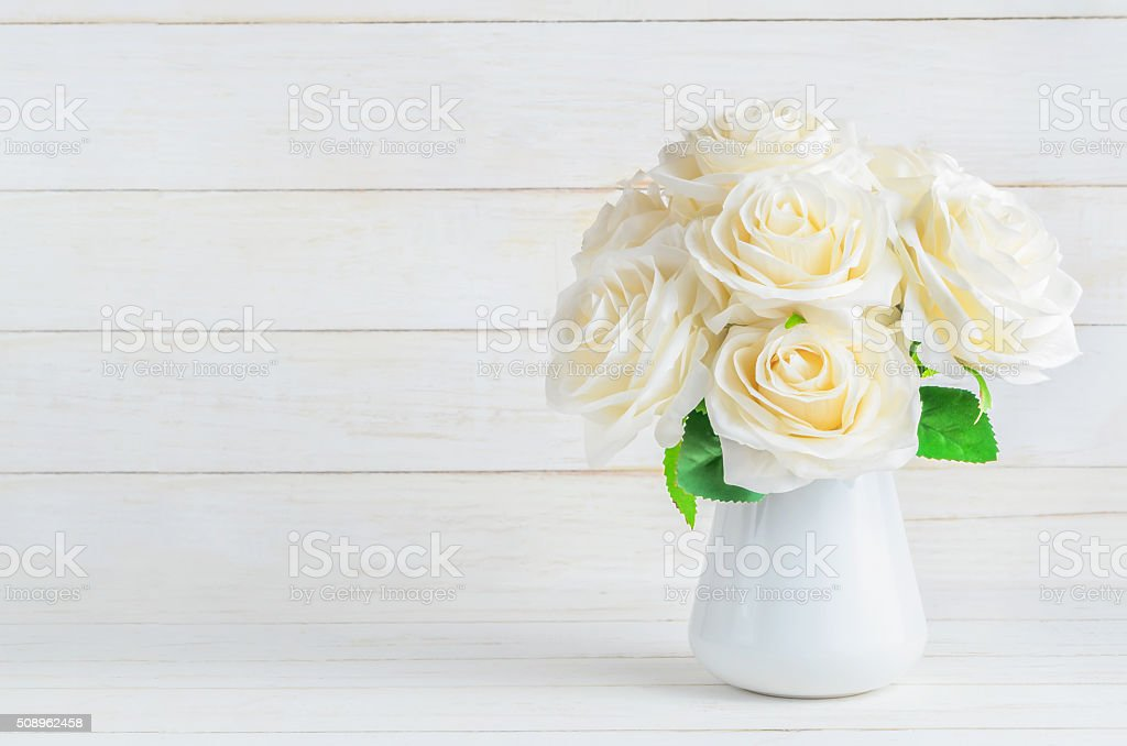 White artificial roses in vase stock photo