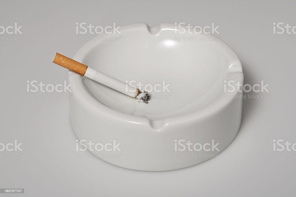 White ashtray with cigarette stock photo