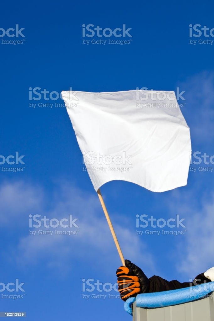 White Auto Race Flag against a Blue Sky stock photo