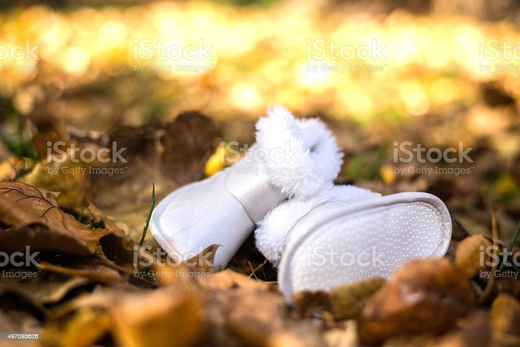 White baby booties stock photo