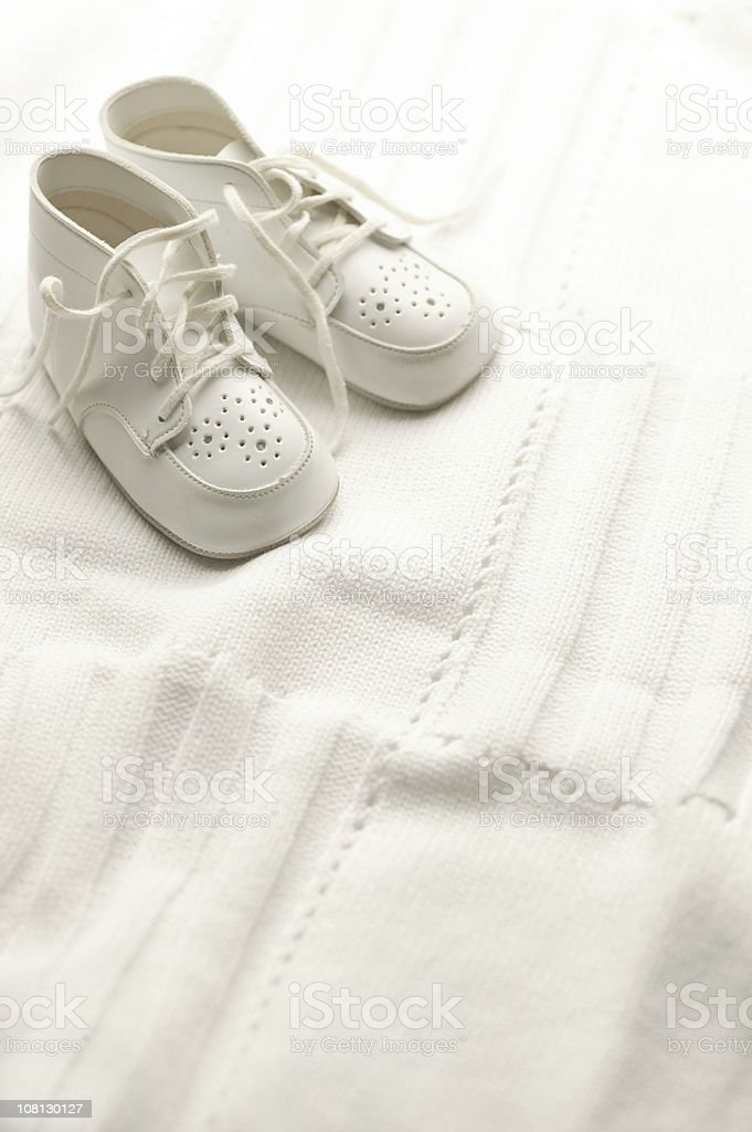 White Baby Shoes on Blanket stock photo