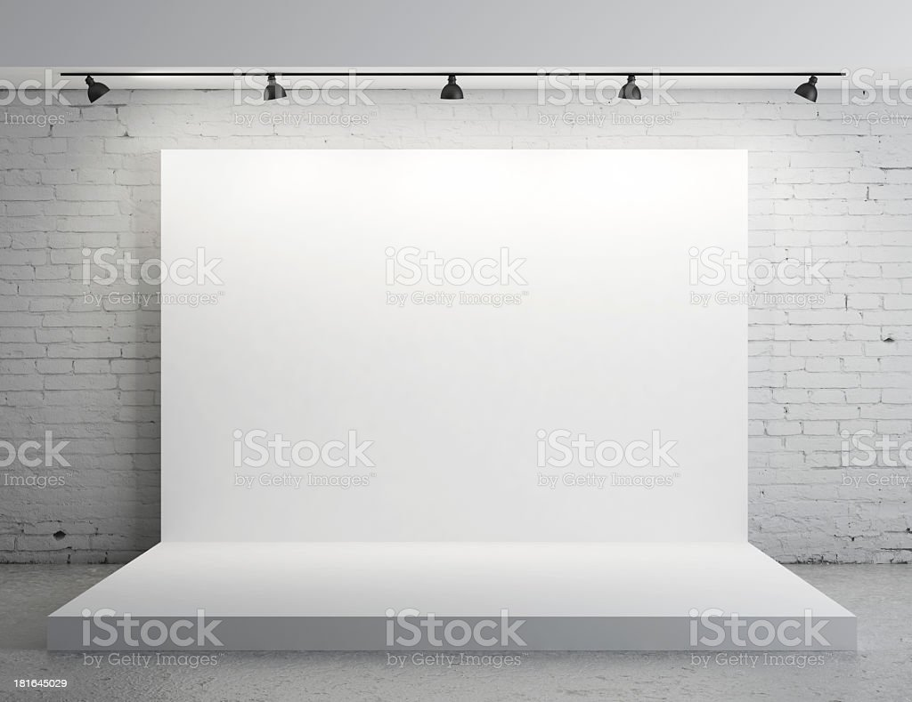 A white backdrop with stage lights stock photo