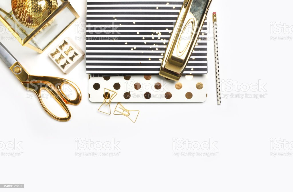 White background. Header website or Hero website, Mockup product view table gold accessories. stationery supplies. glamour style. Gold stapler. Flat lay stock photo