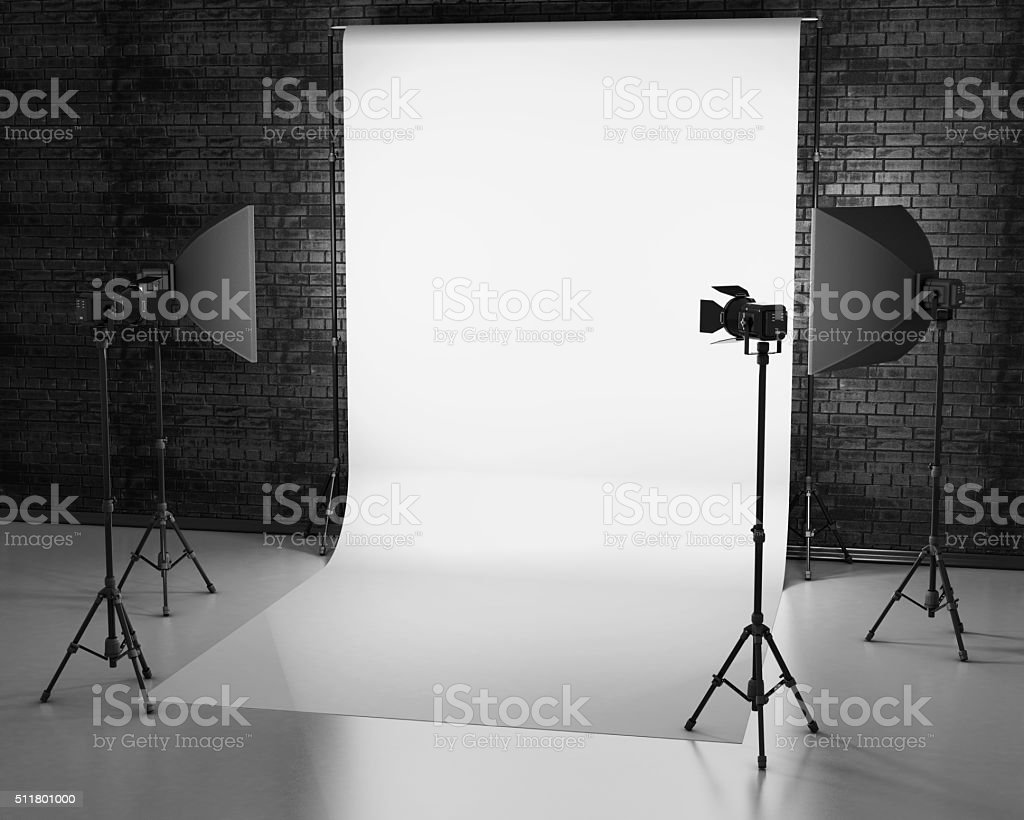 White background lit with Studio equipment against a brick wall. stock photo