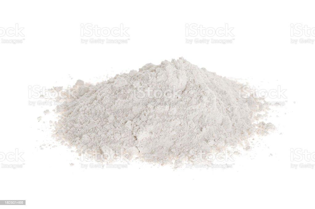 A white background with a mound of white flour  royalty-free stock photo