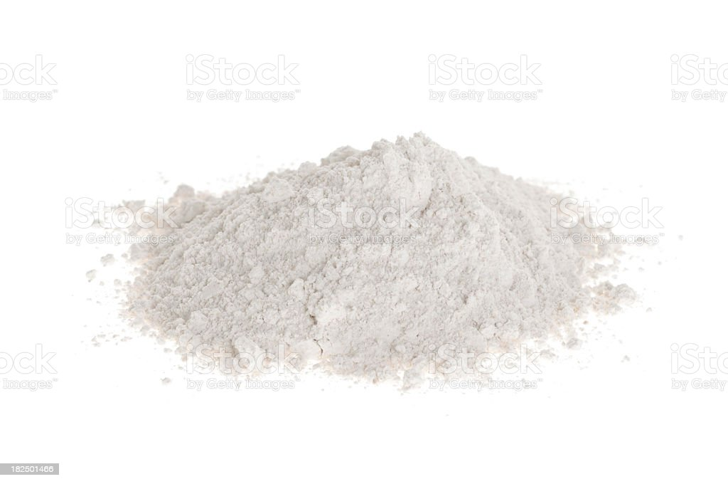 A white background with a mound of white flour  stock photo