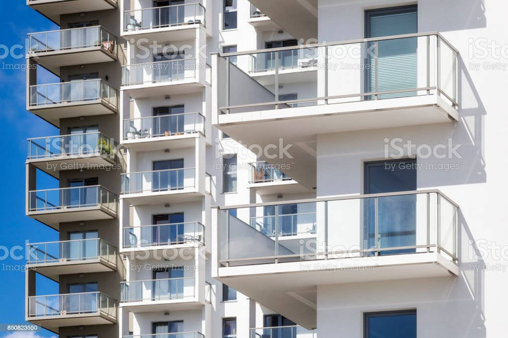 White balconies in modern apartment building stock photo