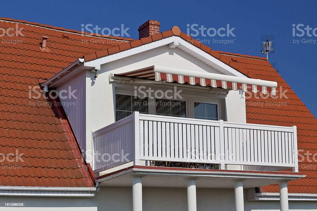 White balcony and red roof royalty-free stock photo