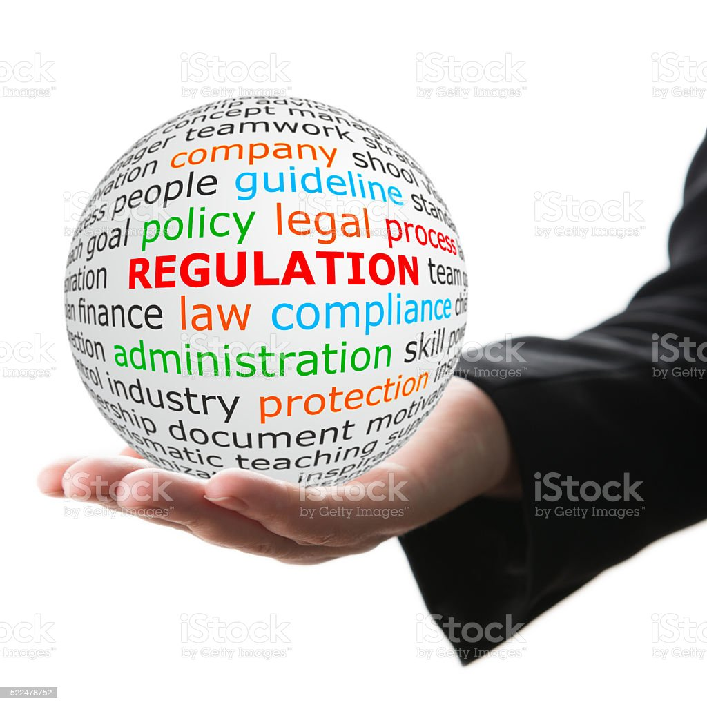 white ball in hand with red inscription regulation stock photo