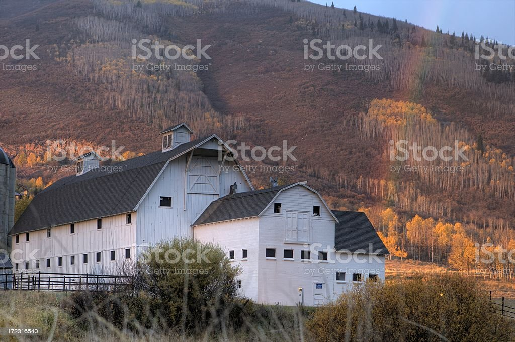 White Barn with a Rainbow stock photo
