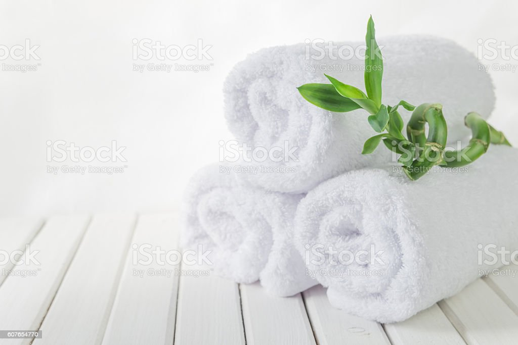 White bath towels and Lucky bamboo stock photo