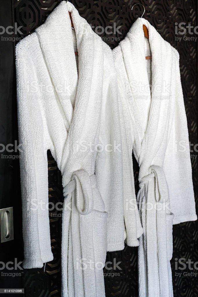 white Bathrobe on a hanger stock photo