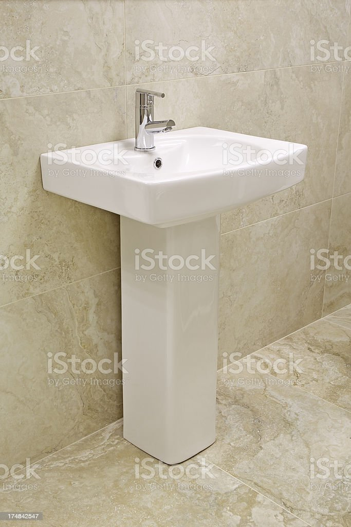 white bathroom sink and pedestal stock photo