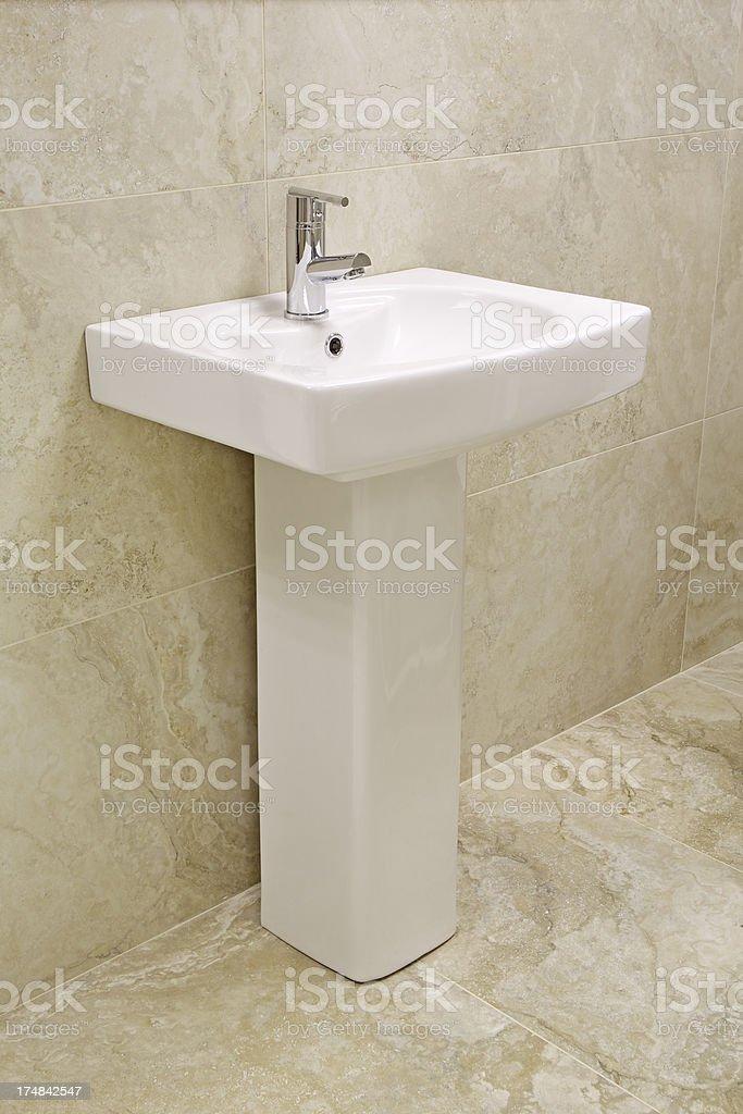 white bathroom sink and pedestal stock photo