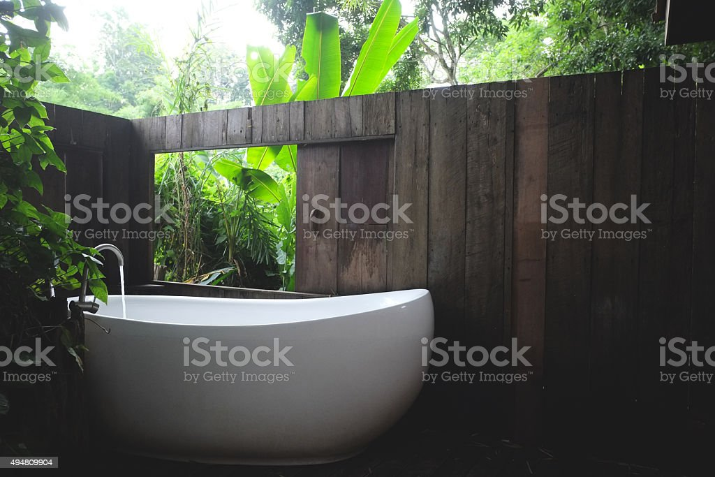white bathtub in outdoor bath stock photo