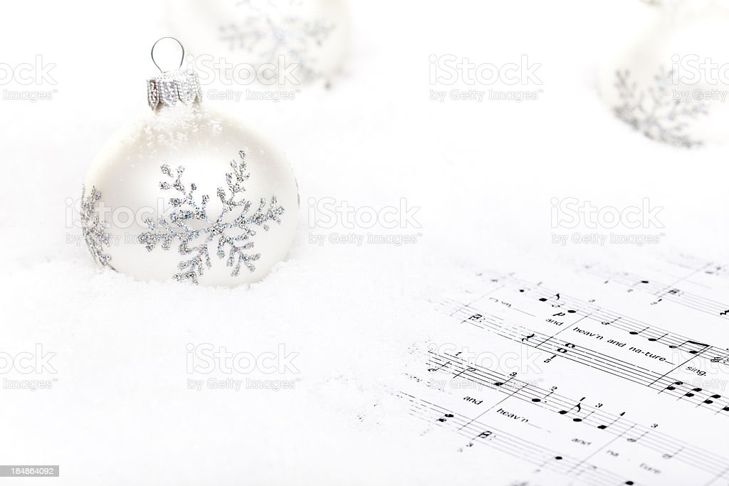 White Baubles on snow royalty-free stock photo