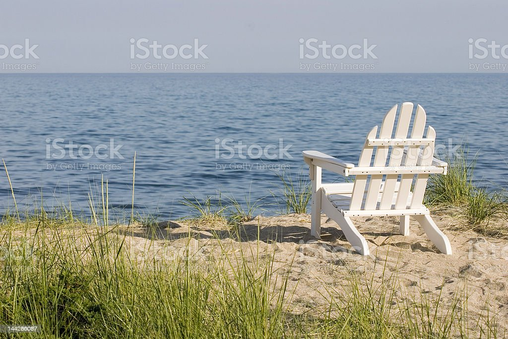 white beach chair landscape stock photo
