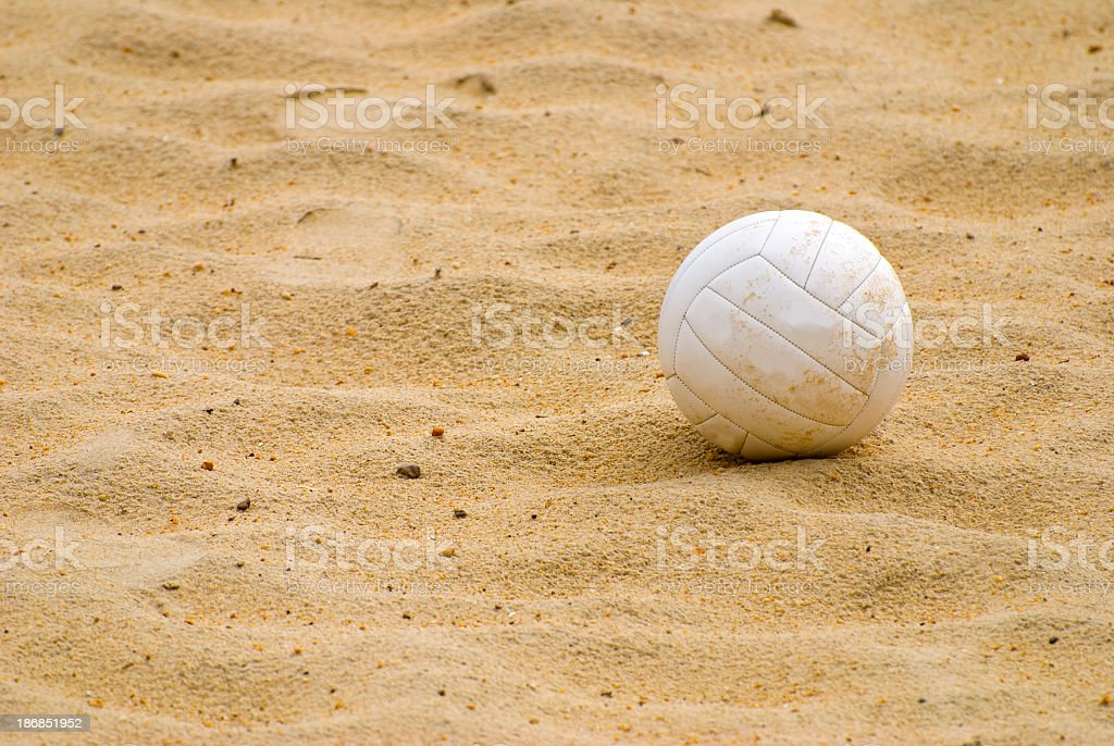 White beach volleyball on sand stock photo