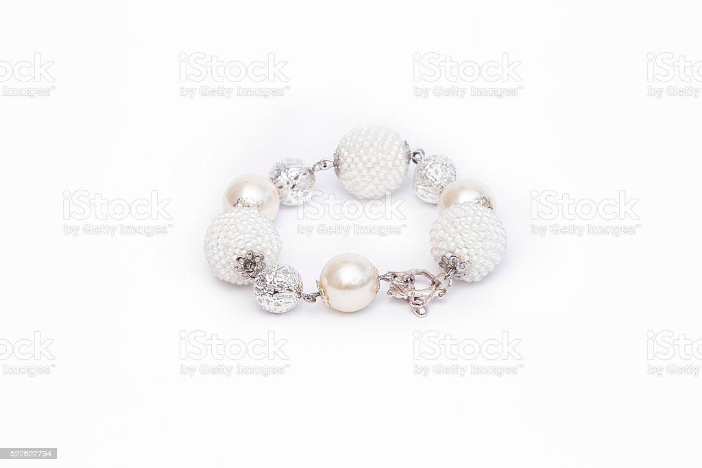 White beaded bracelet isolated stock photo