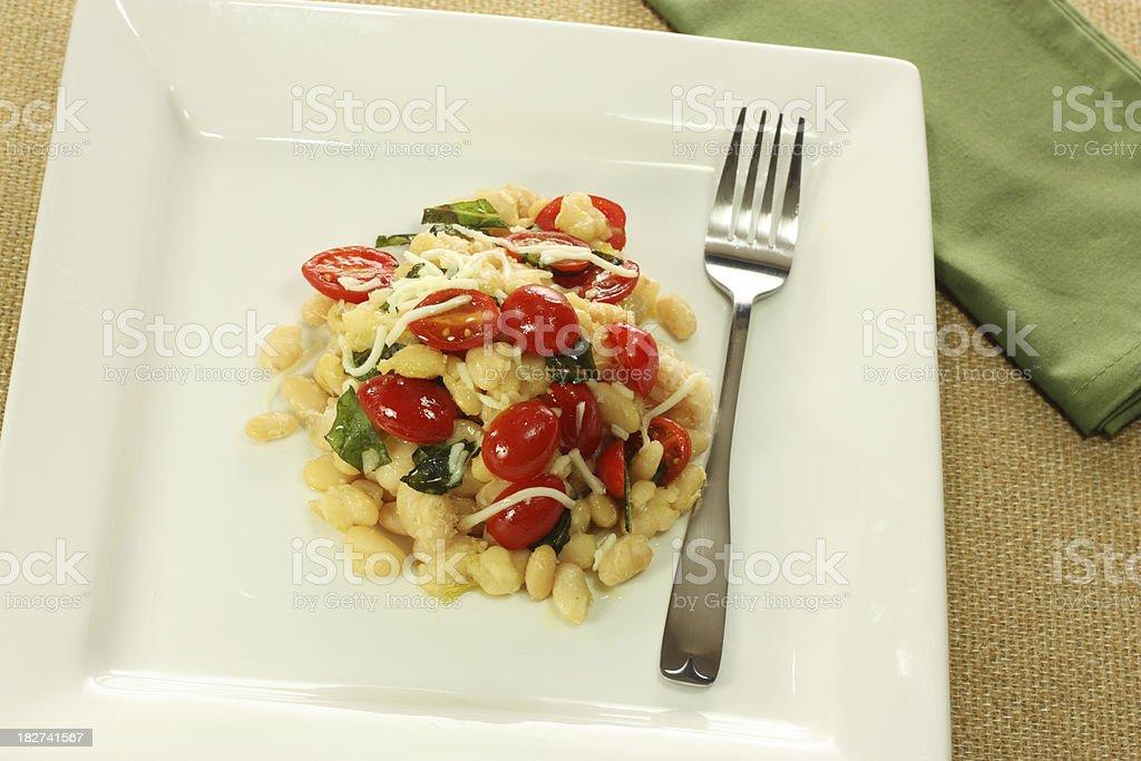 White bean and tomato salad stock photo