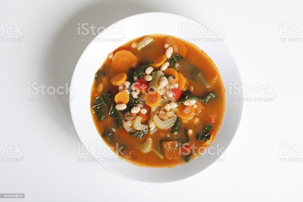 White Bean, Kale and Tomato Soup stock photo