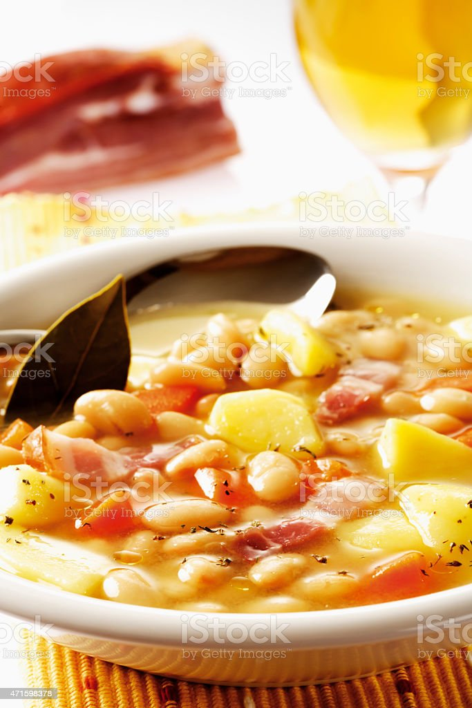 White bean soup with potato and bacon stock photo