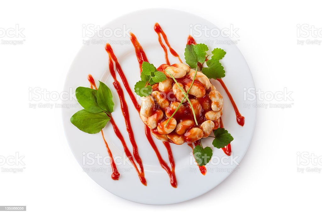 White beans in tomato sauce on a dish royalty-free stock photo