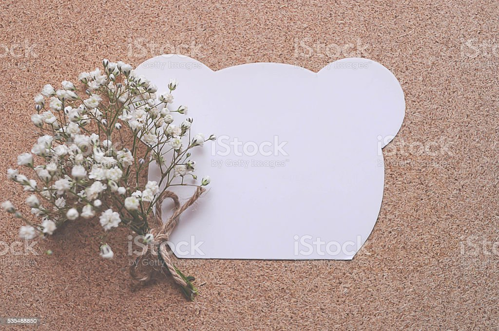 White Bear Notebook with white flower on table. stock photo