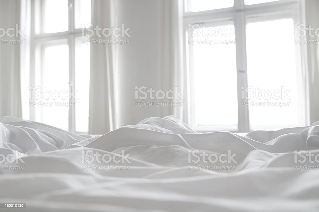 White bed linen stock photo