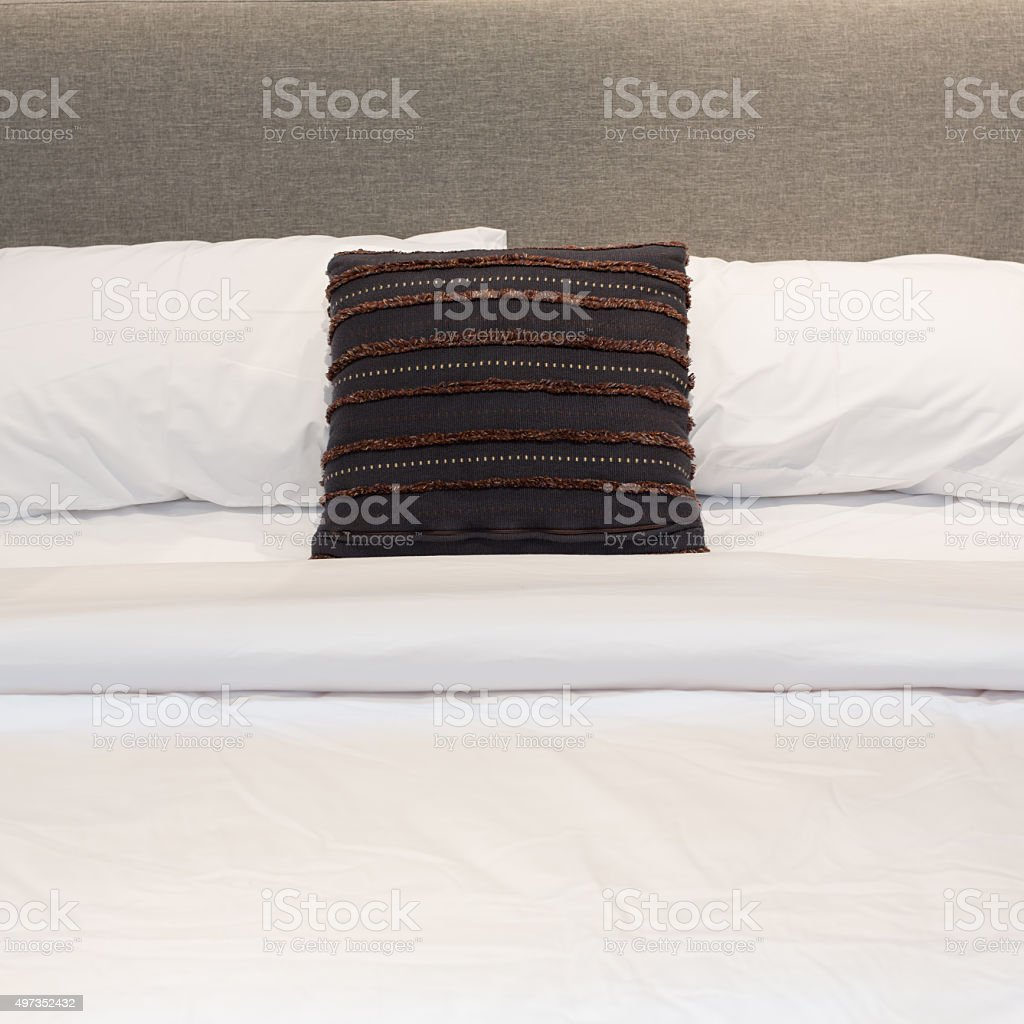 White bed , pillows , blanket, and sheet stock photo