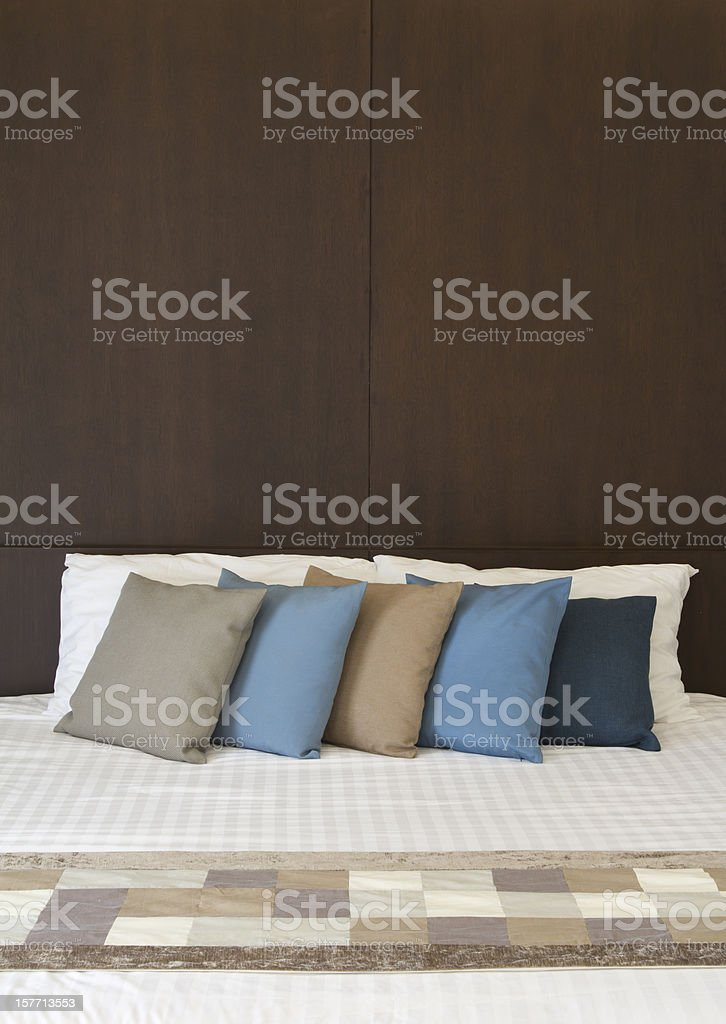 White bed with Multi color pillows royalty-free stock photo
