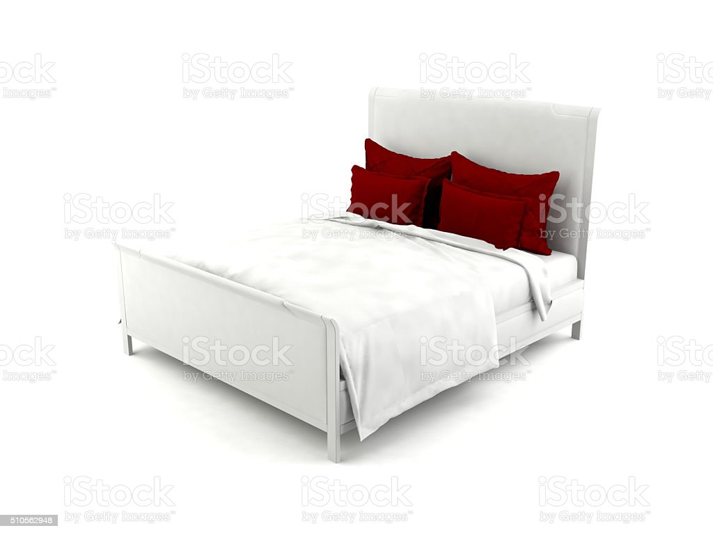 White bed with red pillows stock photo