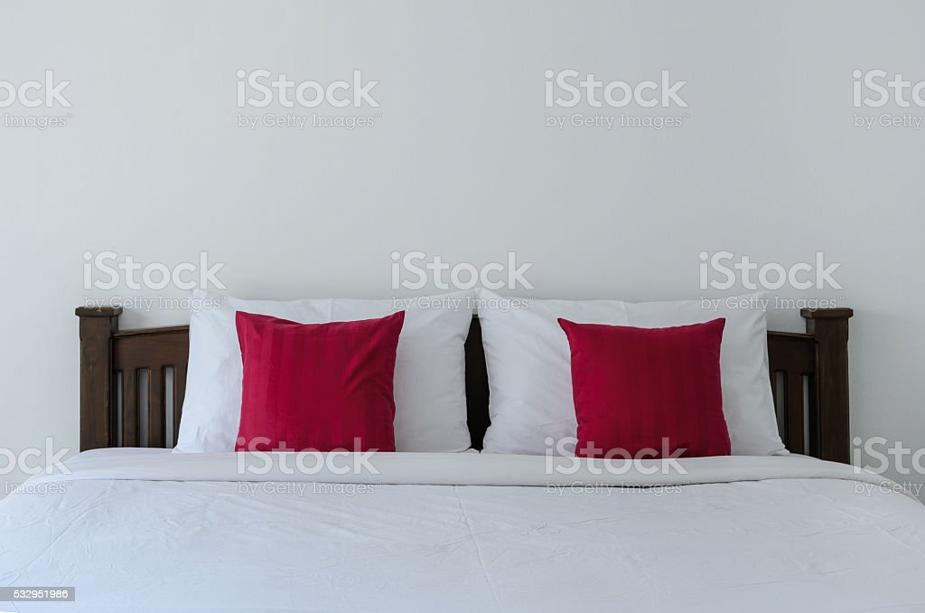 White bedroom with tidy white bed stock photo