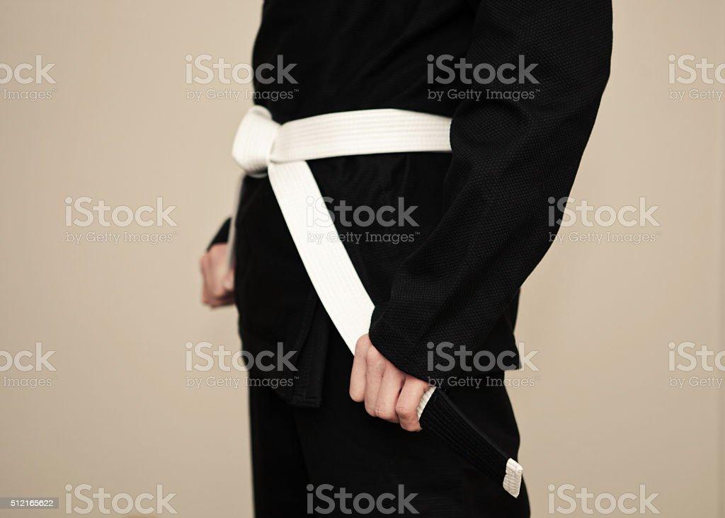 White belt and black kimono stock photo