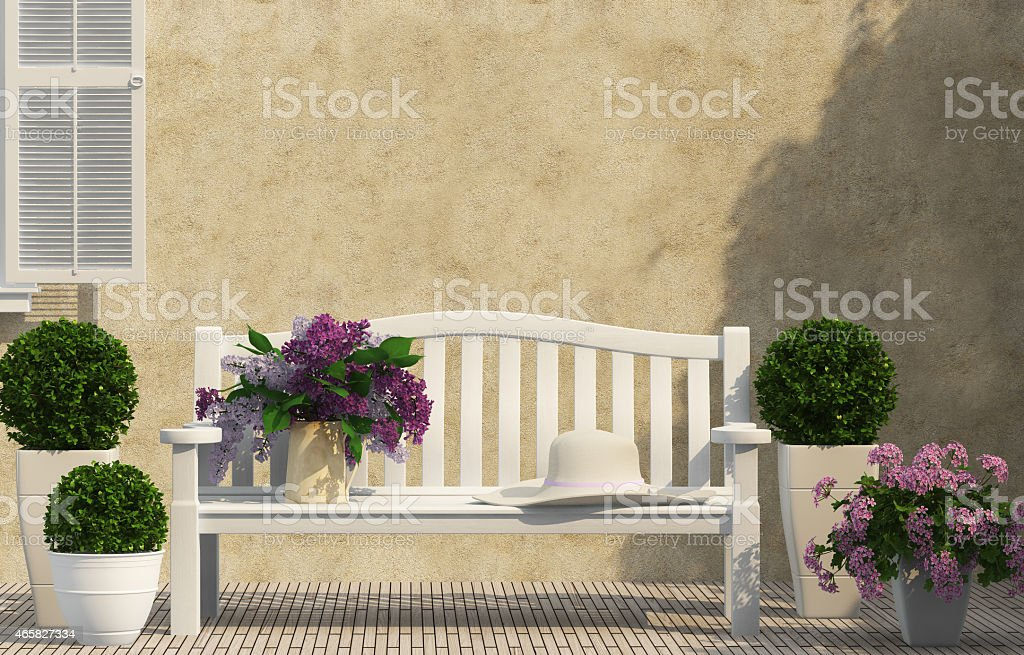 White bench, green and lilac flowers stock photo