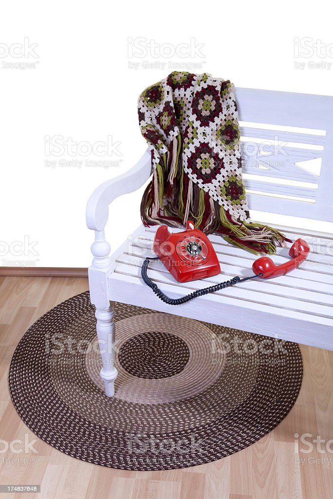 white bench with red telephone royalty-free stock photo