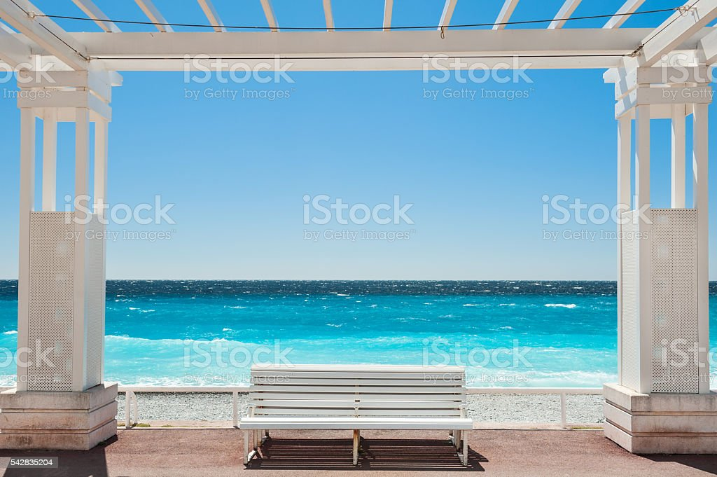 White benches on the Promenade des Anglais in Nice, France stock photo