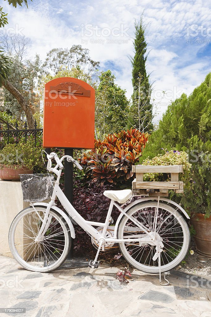 White bicycle in the garden royalty-free stock photo