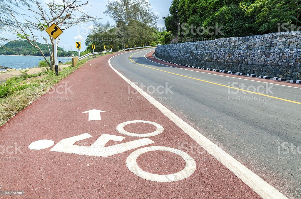 White bicycle path way sign on the roadside stock photo