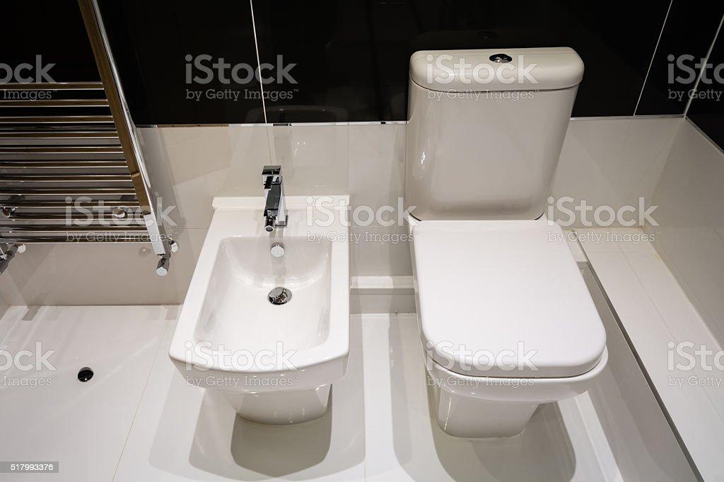 White Bidet and Toilet stock photo
