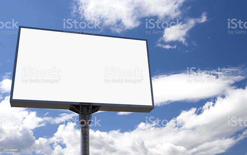 white bill board advertisement under sky with clouds royalty-free stock photo