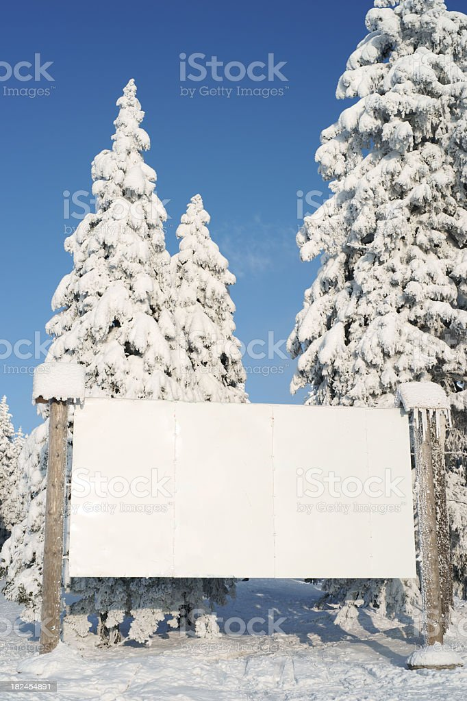 White billboard in winter - vertical royalty-free stock photo