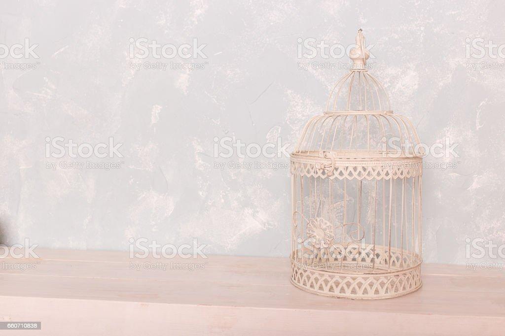 white bird cage on the wooden floor stock photo