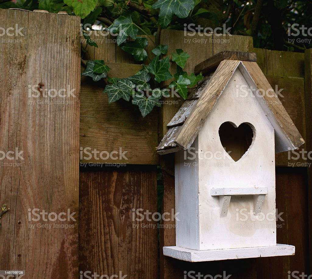 White birdhouse royalty-free stock photo