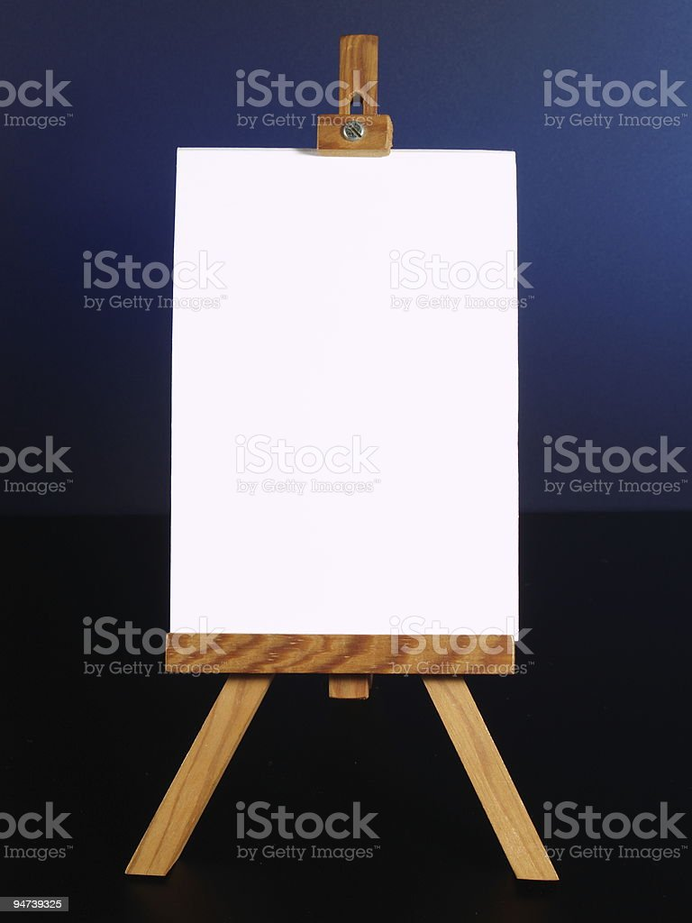 white blackboard on easel royalty-free stock photo